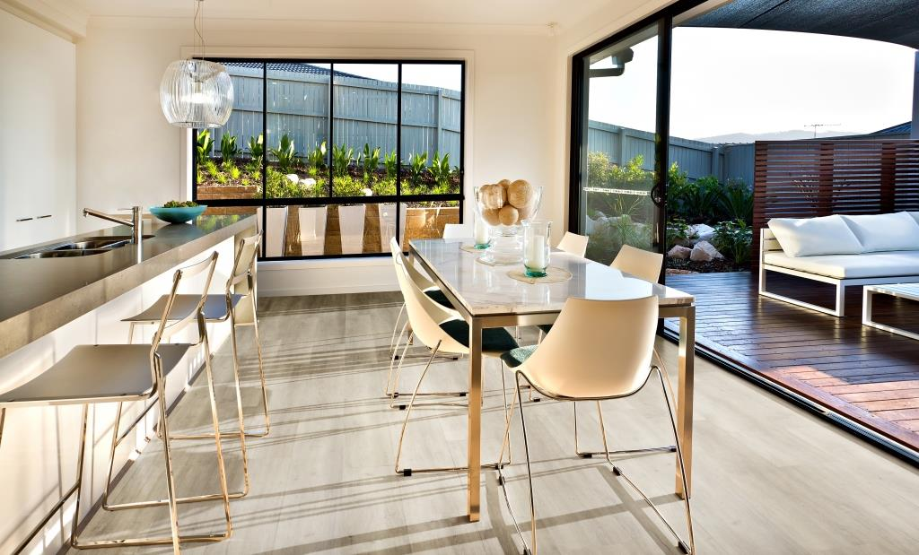 Modern kitchen and dining area on the wooden floor